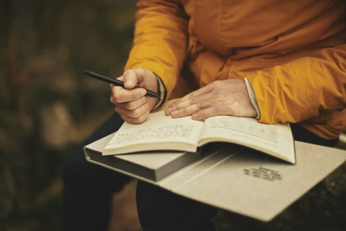 write-notebook-hand-orange