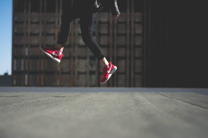 jump-red-sneakers-cement