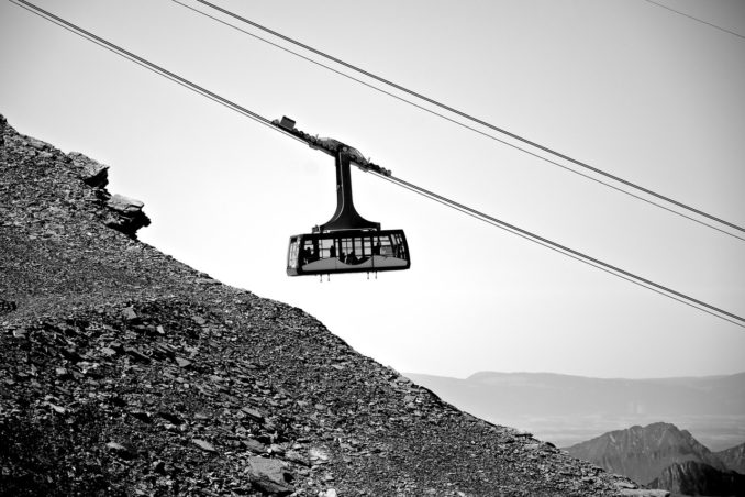 black-and-white-mountains-stones-cable-railway